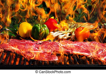 Steaks on the grill - Stock image of steak and vegetables on...