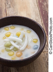 Thai sweetmeat with colorful ball flour, coconut, milk and...
