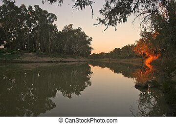 River sunset - Last light paints a rosy glow on a section of...