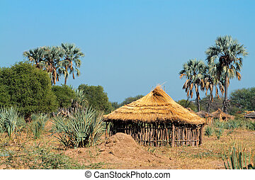 Rural African hut - Traditional rural African wood and...