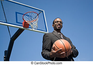 Basketball Pro - African American man in a business suit...