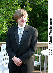 Tuxedo Teen Secretive Smile - Three-quarter length view of a...