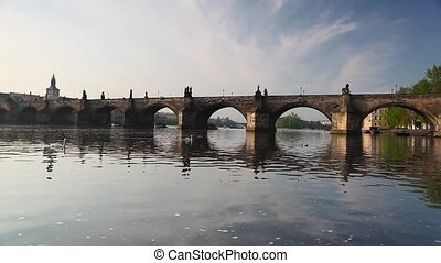 Charles Bridge in Prague at sunrise - View from Kampa of...