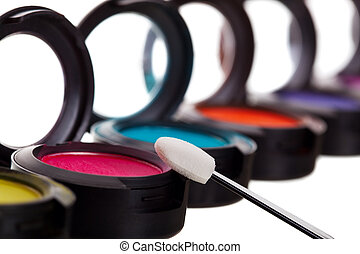 Eyeshadow Pots With Brush - A colorful row of eyeshadow pots...