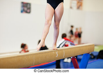 Gymnastics - A gymnastics competitor on the balance beam.