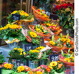 Street show-window of flower shop in Europe