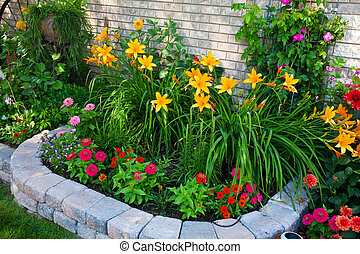 Colorful Flower Bed - A stone edged, urban flower bed that...