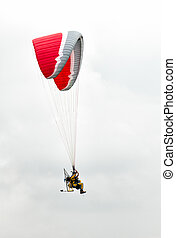 Air show paramotors - Man with paramotor in the sky