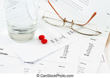Bills and glasses - Different bills to be paid. envelopes...