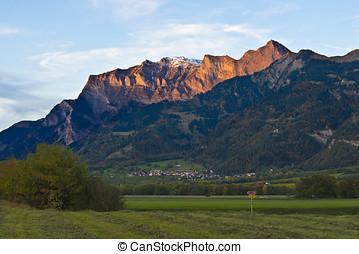 Alpenglow over the border Switzerland - Liechtenstein. The...