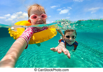Kids having fun swimming on summer vacation - Split above...