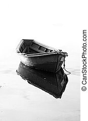 One boat, one reflection - Close view of a traditional...