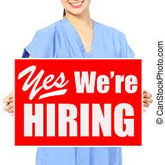 We Are Hiring - A medical person holding a recruitment sign...