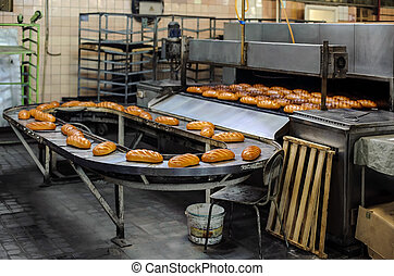 Breads on production line at bakery - freshly baked hot...