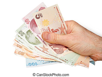Turkish Currency - A hand holding a mixture of Turkish Lira...