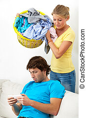 Dirty clothes - Woman is throwing dirty clothes on her lazy...