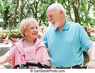 Active Senior Bikers - Active senio couple ride their...