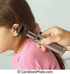 Ear examination - A close-cropped image of a doctor...