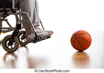 Disabled athlete - Male disabled athlete and ball on the...