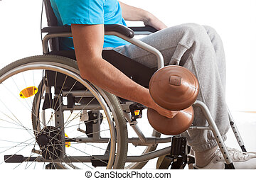 Man in wheelchair lifting weight on isolated white...