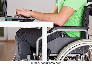 Wheelchair worker - Close-up of wheelchair worker using...