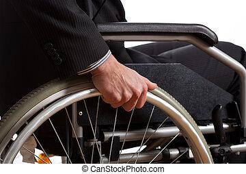Male hand on wheel of wheelchair