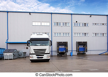 Shipping cargo truck at warehouse building