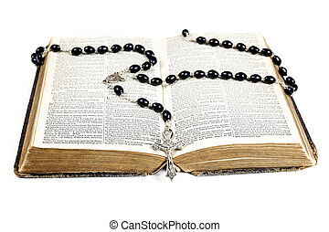 Rosary beads, cross and Bible - Rosary beads and cross lying...