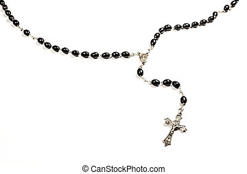 Rosary Beads. - Rosary beads and metal cross isolated on a...