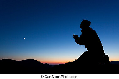 Man Pleading - Man pleading on the summit of a mountain at...