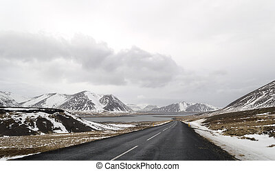 the road to snaefellsne on the island iceland with lake and...