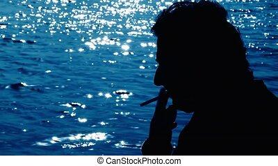 Man smoking near the sea