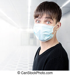 Teenager in Flu Mask - Surprised Teenager in the Flu Mask