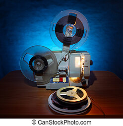 Film Projector - Old 8mm film projector in dusk beside a...