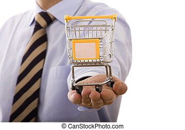 shopping opportunities - businessman holding a shopping cart...