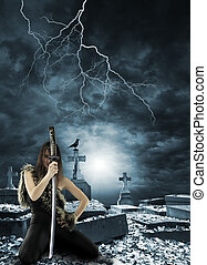 Female warrior holding a katana sword at the graveyard