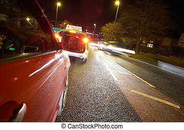 Learner Driver - Learner driver on a busy road at night.