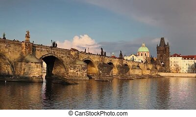 View from Kampa of Charles Bridge in Prague at sunset