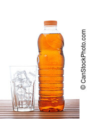 Ice tea - A empty glass and bottle of ice tea on wooden...