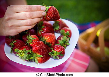 A plate full of strawberies