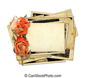 Pile of old photos and letters with bouquet of dried roses...