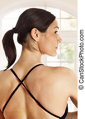 Yoga back - Young woman with beautifuly muscular back is...
