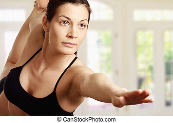 Yoga - Young woman is doing an expert yoga exercise