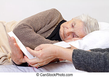 Reading - Picture of an elderly woman reading a book
