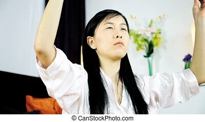 Concentration and meditation - Asian woman concentrating...