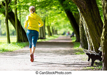 Woman runner running jogging in summer park - Woman runner...