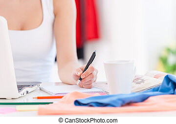 Working in design studio Cropped image of woman working at...