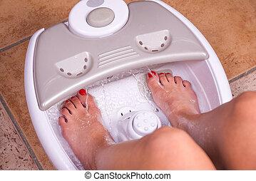Feet massager - Woman's feet in a vibrating feet massager