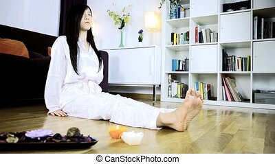 Chinese woman meditating at home - Tracking shot of asian...