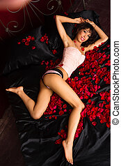 Beautiful Young Adult Woman Laying Black Satin Red Rose...